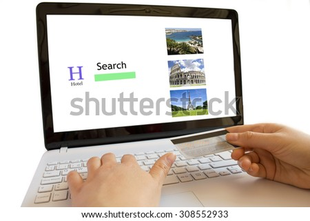 businesswoman hotel booking with  computer and credit card - stock photo