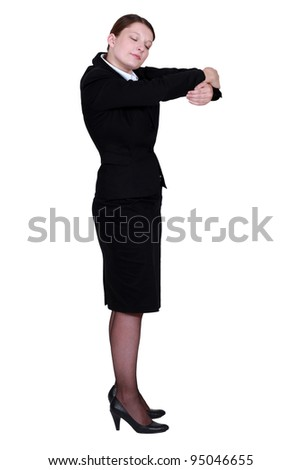 Businesswoman hugging an invisible object - stock photo