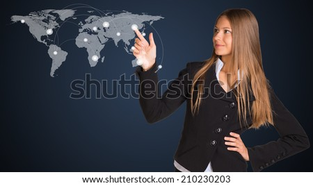 Businesswoman in a suit presses the virtual world map - stock photo