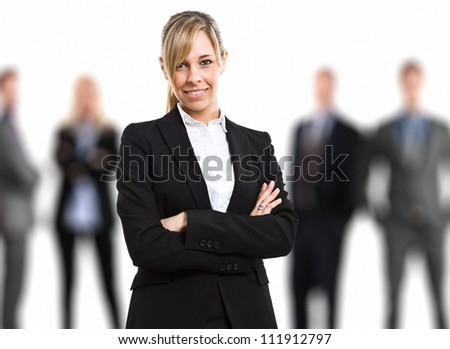 Businesswoman in front of his team - stock photo