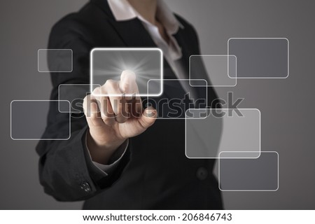 Businesswoman in front of visual touch screen. - stock photo
