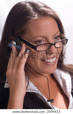 Businesswoman in glasses with Headset - stock photo