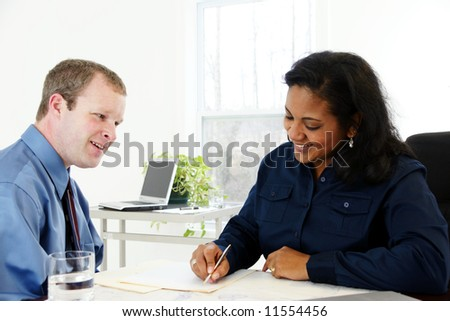 Businesswoman in her office - stock photo