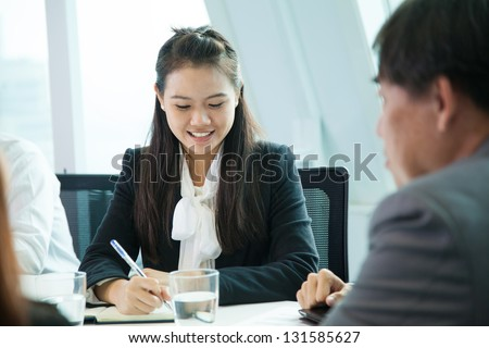 Businesswoman in meeting room - stock photo