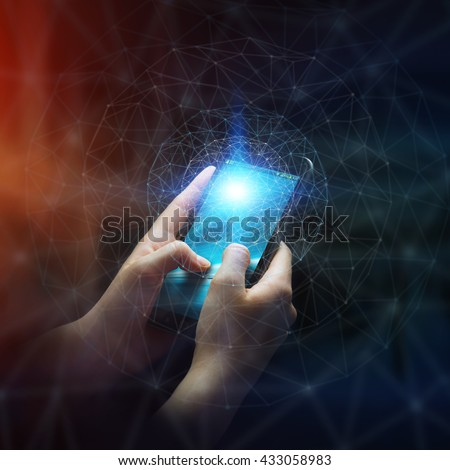 Businesswoman in office using digital data network with his mobile phone - stock photo