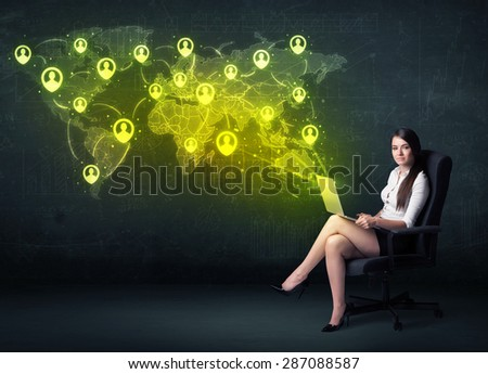 Businesswoman in office with laptop and social network world map concept on background - stock photo
