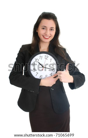 Businesswoman in suit holding a clock and showing a thumbs up gesture over white - stock photo