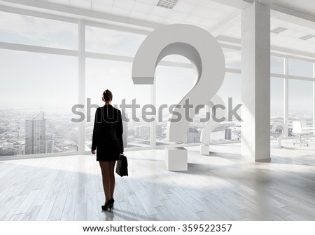Businesswoman in top floor office - stock photo