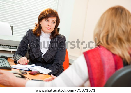 Businesswoman interviewing a candidate - stock photo