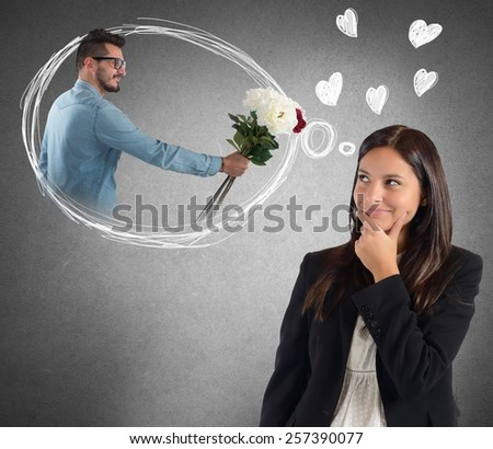 Businesswoman is distracted thinking about boyfriend surprise - stock photo