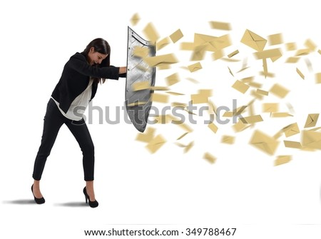 Businesswoman is protected with shield by letters - stock photo
