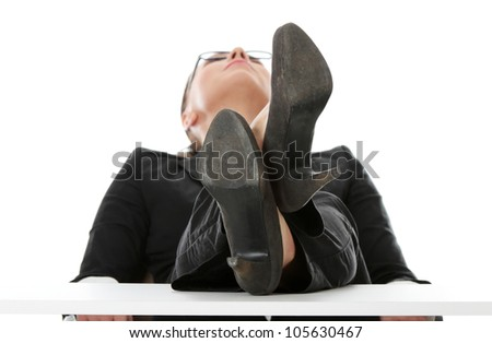 Businesswoman is siting with feet up, based on the table and looking up. Isolated on the white background. - stock photo