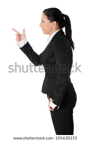 Businesswoman is standing sideways. Isolated on the white background. - stock photo