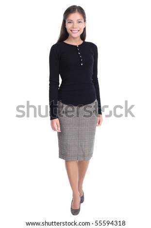 Businesswoman isolated walking towards the camera in full length Casual beautiful young mixed race chinese / caucasian business woman isolated on white background. - stock photo