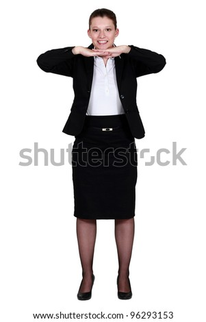 Businesswoman leaning her chin on her hands. - stock photo