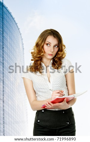 Businesswoman listening and writing notes looking sidewards isolated on white background - stock photo