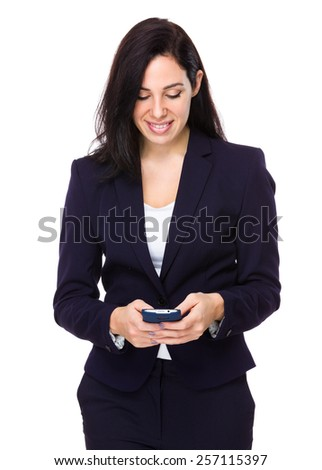 Businesswoman look at cellphone - stock photo