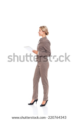businesswoman look side to copy space hold tablet computer, business woman, full length wear fashion wool suit isolated over white background - stock photo