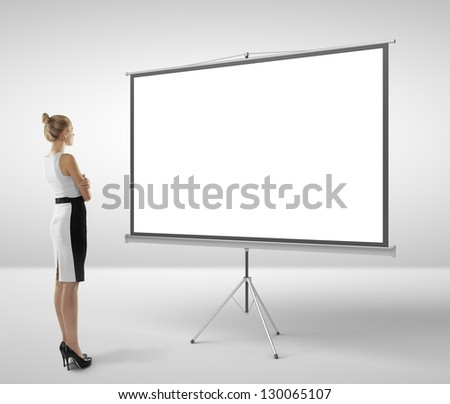 businesswoman looking at blank flip chart - stock photo