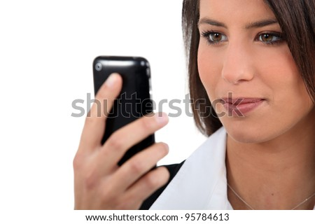 Businesswoman, looking at mobile telephone - stock photo