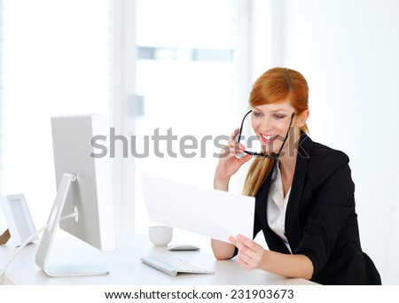 Businesswoman looking into some papers - stock photo