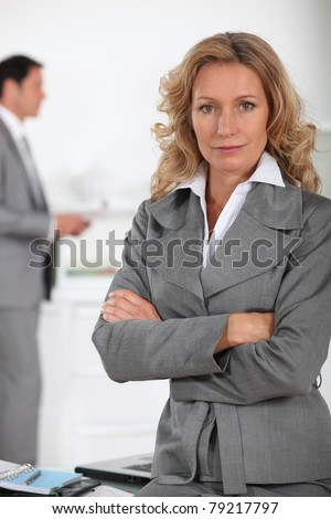Businesswoman looking serious - stock photo