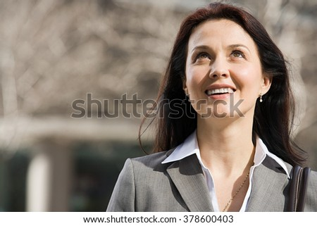 Businesswoman looking up - stock photo