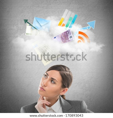 Businesswoman looking using cloud technologies to store her data and be free and mobile - stock photo