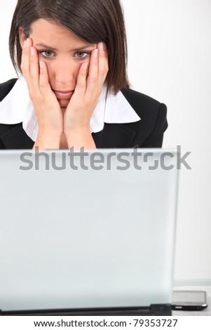 Businesswoman looking worried - stock photo