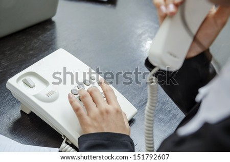 Businesswoman making a phone call - stock photo