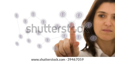 businesswoman managing her contact network, pressing hi-tech buttons on a whiteboard (selective focus) - stock photo