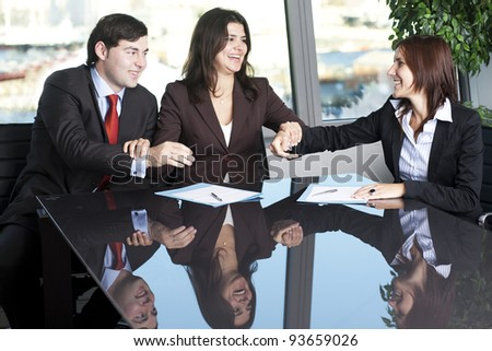 Businesswoman mediating and making business conciliation possible - stock photo
