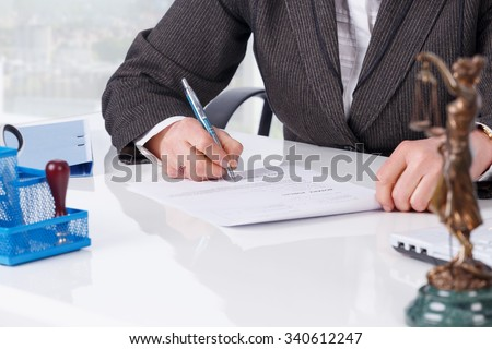 Businesswoman notarize document at notary public office - stock photo