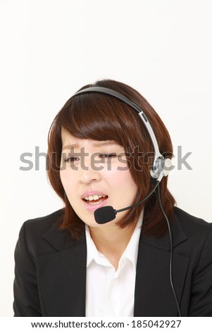 businesswoman  of call center perplexed to a complaint telephone - stock photo