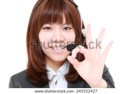 businesswoman of call center showing perfect sign - stock photo
