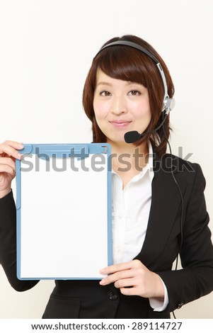 businesswoman of call center with message board - stock photo