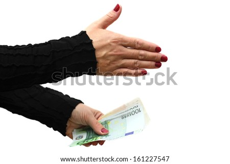 Businesswoman offering handshake with money - stock photo