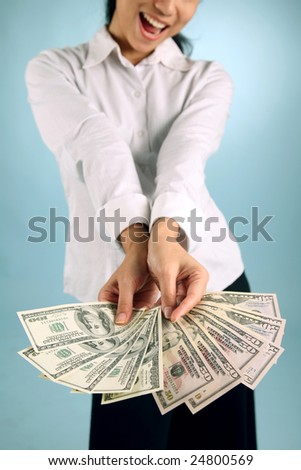 Businesswoman offering some free cash - stock photo