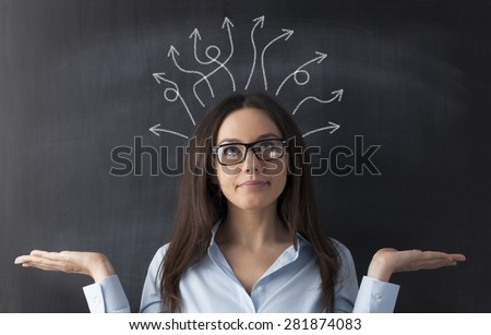 Businesswoman on blackboard and many twisted arrows in her head - stock photo