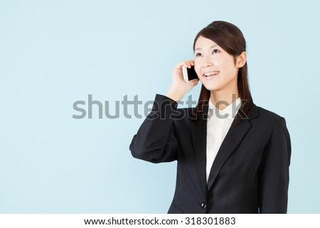 Businesswoman phone smile - stock photo