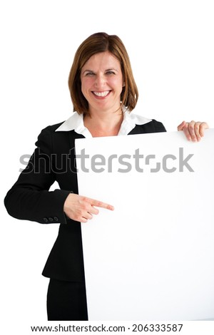 businesswoman pointing at a blank white board isolated - stock photo