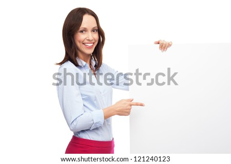 Businesswoman pointing at blank poster - stock photo