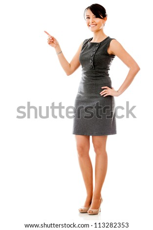Businesswoman pointing something - isolated over a white background - stock photo