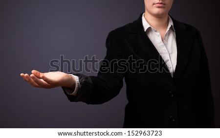 Businesswoman presenting empty space - stock photo