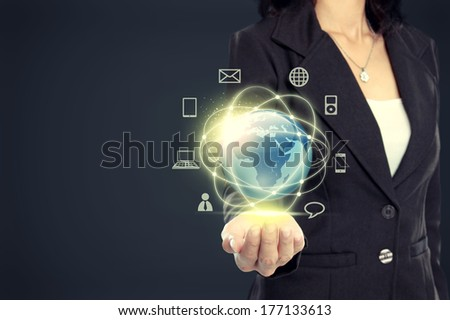 Businesswoman presenting global network media concept - stock photo