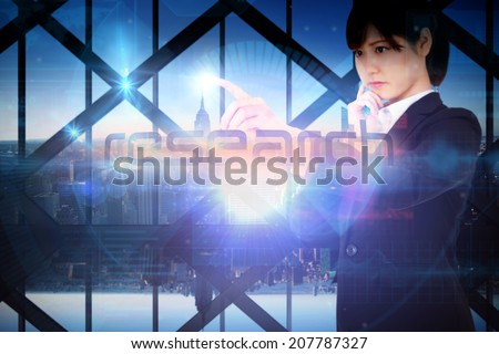 Businesswoman presenting the word research against room with large window looking on city - stock photo