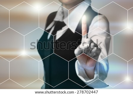 Businesswoman presses a button on the touch screen. - stock photo