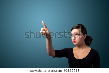 Businesswoman pressing an imaginary button, empty space for buttons - stock photo