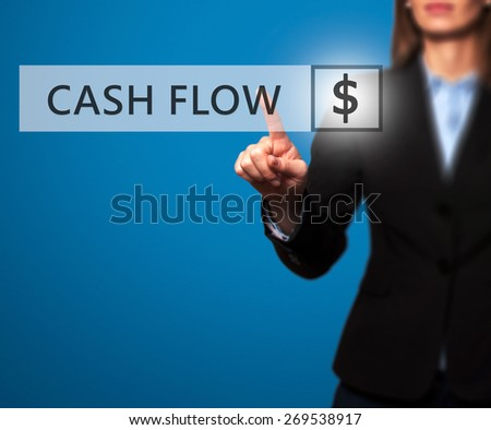 Businesswoman pressing Cash Flow button on virtual screens.Women finger on dollar icon. Isolated on blue. Business, technology and internet concept - Stock Image - stock photo