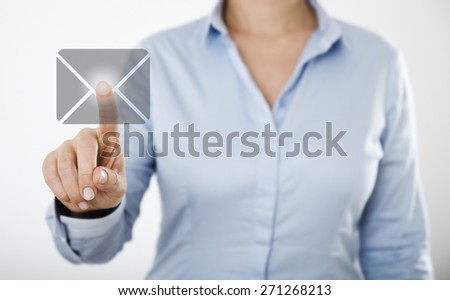Businesswoman pressing e-mail icon button on the digital touch screen  - stock photo